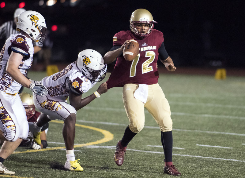 09/13/19  Wesley Bunnell | Staff  New Britain football was defeated at home by South Windsor on Friday night.  Monte Dickson (12) scrambles but is brought down.