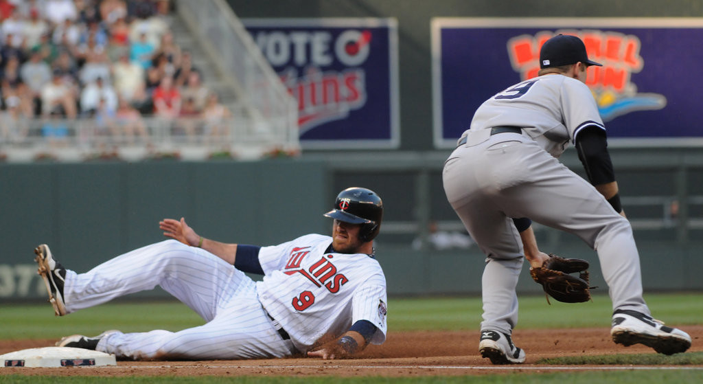 . Minnesota catcher Ryan Doumit slides into third just ahead of the throw to New York third baseman David Adams on a Minnesota third baseman Trevor Plouffe sacrifice fly during the first inning. (Pioneer Press: John Autey)