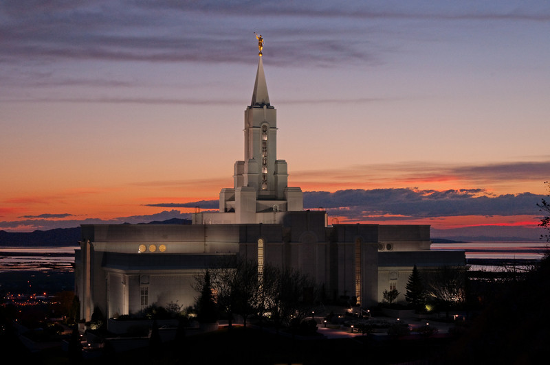 Bountiful Utah Temple at sunset. I figured out my big mistake. I didn't wait for the flood lights to really warm up. That's why the temple looks as dark as it does. Unfortunately I had people waiting for me, so I wasn't able to wait that long. I still consider it time well spent. The view was amazing, and it was great to just stand there on the hillside above the temple and take it all in.