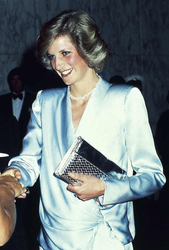 Description of . Princess Diana smiles at the premiere of the film