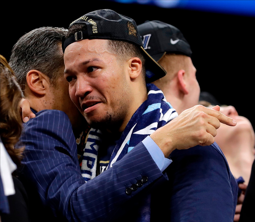 . Villanova\'s Jalen Brunson, right, hugs head coach Jay Wright after the championship game of the Final Four NCAA college basketball tournament against Michigan, Monday, April 2, 2018, in San Antonio. Villanova won 79-62. (AP Photo/Eric Gay)