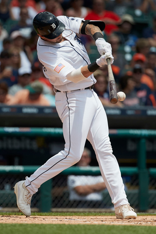 . Detroit Tigers\' Nicholas Castellanos hits a single against the Cleveland Indians during the second inning in the first baseball game of a doubleheader in Detroit, Saturday, July 1, 2017. (AP Photo/Rick Osentoski)