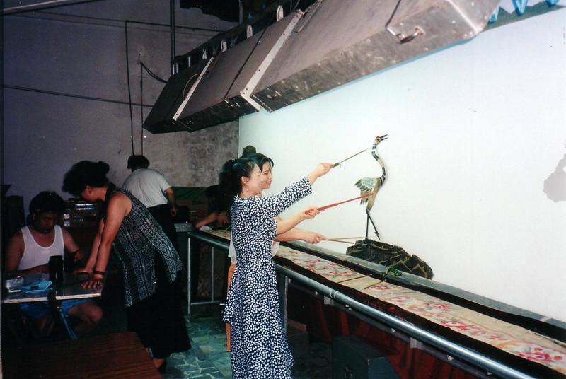 Beijing 1997, behind the scenes of the shadow pupet show.