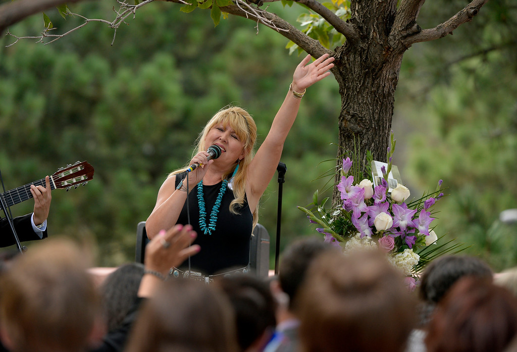 . Annette Espinoza sings during a memorial service for Wesley Quinlan and Wiyanna Nelson at the National Center for Atmospheric Research in Boulder, CO September 21, 2013. Espinoza is Wesley\'s aunt.  (Photo By Craig F. Walker / The Denver Post)