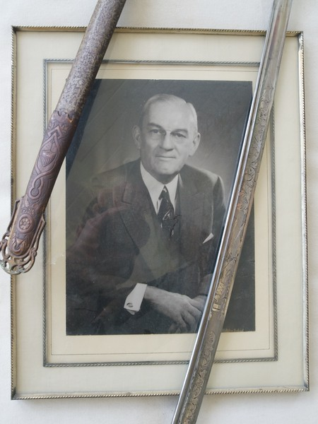 William Wallace's Civil War sword and scabbard, over portrait of Harry Jones.