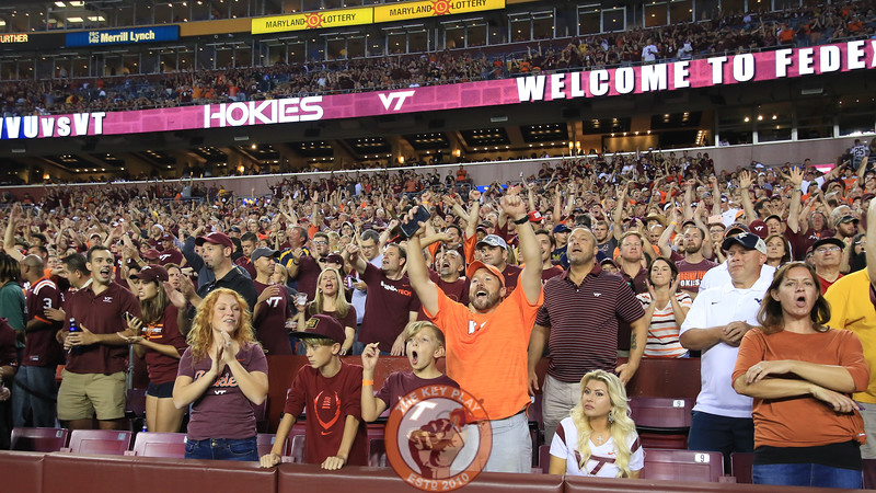 Fans on the Virginia Tech side of FedEx field cheer after a call is reversed in the Hokies' favor. (Mark Umansky/TheKeyPlay.com)