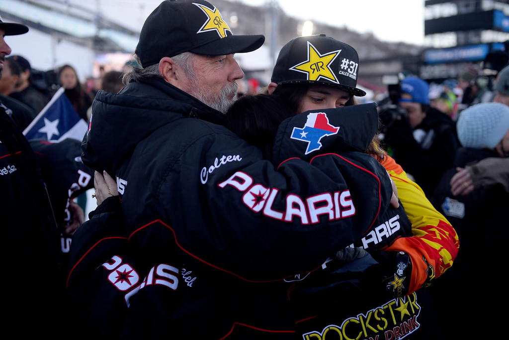 . ASPEN, CO - JANUARY 25: Wade and Michelle Moore hug their son, Colten, during a celebration for their late son, Caleb, who was killed in the snowmobile freestyle event at the 2013 X Games Aspen. X Games Aspen at Buttermilk on Friday, January 25, 2014. (Photo by AAron Ontiveroz/The Denver Post)