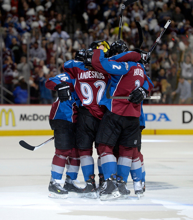 . Nathan MacKinnon (29) of the Colorado Avalanche is congratulated by teammates after scoring the first Avalanche goal of the game during the first period of action. The Colorado Avalanche hosted the Minnesota Wild in the first round of the Stanley Cup Playoffs at the Pepsi Center in Denver, Colorado on Saturday, April 19, 2014. (Photo by John Leyba/The Denver Post)