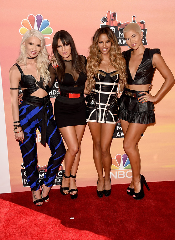 . LOS ANGELES, CA - MAY 01:  (L-R) Singers Lauren Bennett, Natasha Slayton, Emmalyn Estrada and Paula Van Oppen of G.R.L. attend the 2014 iHeartRadio Music Awards held at The Shrine Auditorium on May 1, 2014 in Los Angeles, California. iHeartRadio Music Awards are being broadcast live on NBC.  (Photo by Jason Merritt/Getty Images for Clear Channel)