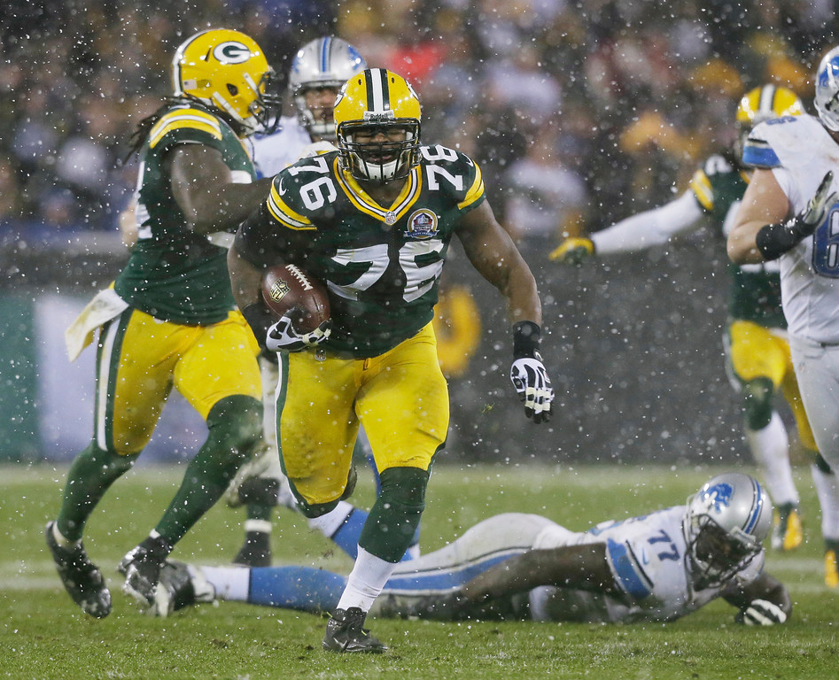 . Green Bay Packers defensive end Mike Daniels (76) picks up a fumble by Detroit Lions quarterback Matthew Stafford and runs it back 43-yards for a touchdown during the first half of an NFL football game Sunday, Dec. 9, 2012, in Green Bay, Wis. (AP Photo/Jeffrey Phelps)