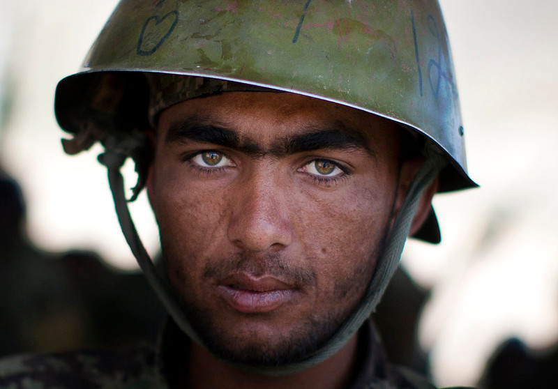 . Afghan Army soldier Ahmad, 20, pauses as he cleans his weapon after a shooting training at a training center on the outskirts of Kabul, Afghanistan on Wednesday, May 8, 2013. In roughly 90 percent of the country, Afghan police and soldiers are taking the fight to the Taliban alone, a first in 12 years of war. U.S. and NATO soldiers have slipped quietly into the background, taking on the role of advisor and providing backup when needed.  (AP Photo/Anja Niedringhaus)