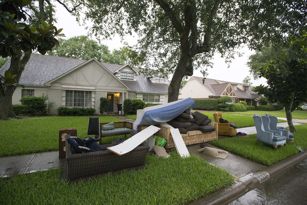 . Damaged homes sit with discarded carpet on the lawn after massive flooding May 27, 2015 in Houston, Texas.  Southeast and central Texas have been hit with severe weather, including catastrophic flooding and tornadoes over the past several days. (Photo by Eric Kayne/Getty Images)