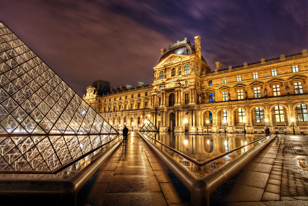 <h2> The Louvre Courtyard, Midnight</h2> Paris. The Louvre. Midnight.  We had the best adventure EVER that day - that will forever define our first visit to paris.   It included walking 8 miles through the streets of Paris at night, experiencing the wonder of the Louvre at midnight - with the place to ourselves and magic all around, missing the last subway at 1am, consoling ourselves with wine, cheese and the most delicious chocolate ever made at 2am on the Champs Elysees.  The stuff dreams are made of, baby.