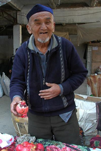 Pomegranate Vendor at Osh Market, Kyrgyzstan
