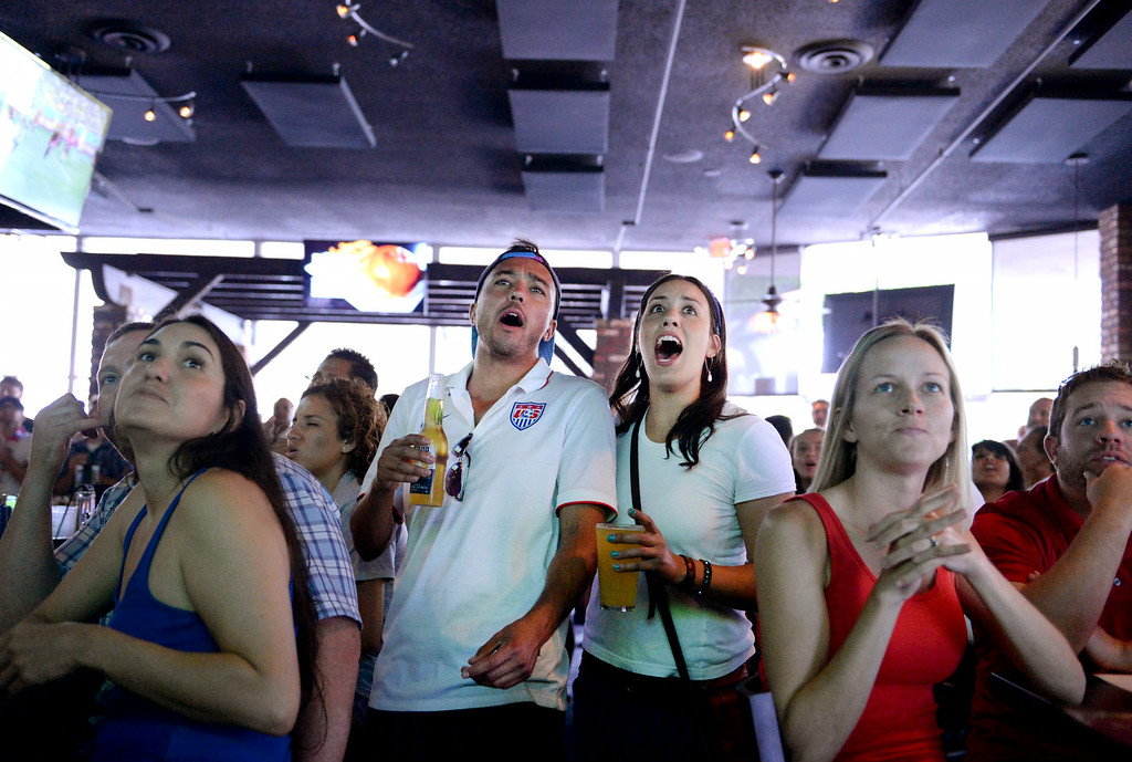 . Liam Muirhead, 27, center, of Redlands, and Mandy Gonzales, 27, of Redlands, watch the USA vs Belgium world cup game at a viewing party on Tuesday, July 1, 2014 at Darby\'s American Cantina in Redlands, Ca. (Photo by Micah Escamilla/The Sun)