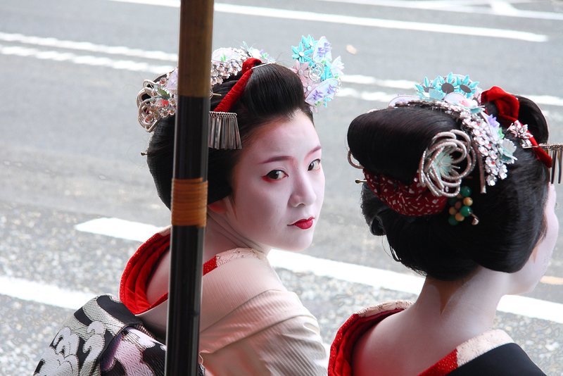 Two geishas participating in Gion Festival. Editorial credit: Sergii Rudiuk / Shutterstock.com