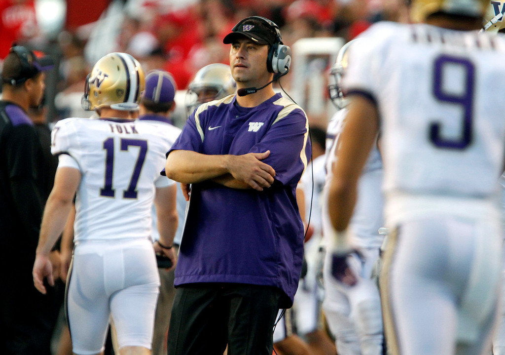 . Washington head coach Steve Sarkisian looks on during the second half of an NCAA college football game against Utah, Saturday, Oct. 1, 2011, in Salt Lake City. Washington won 31-14. (AP Photo/Jim Urquhart)