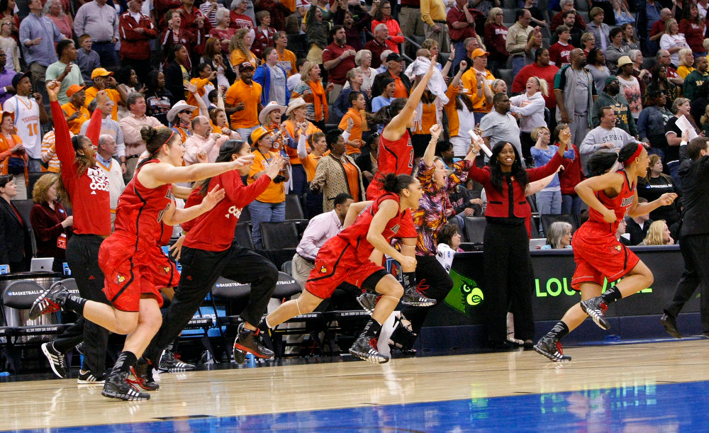 . Louisville\'s bench celebrates after defeating Baylor 82-81 in a regional semifinal in the women\'s NCAA college basketball tournament in Oklahoma City, Sunday, March 31, 2013. (AP Photo/Alonzo Adams)