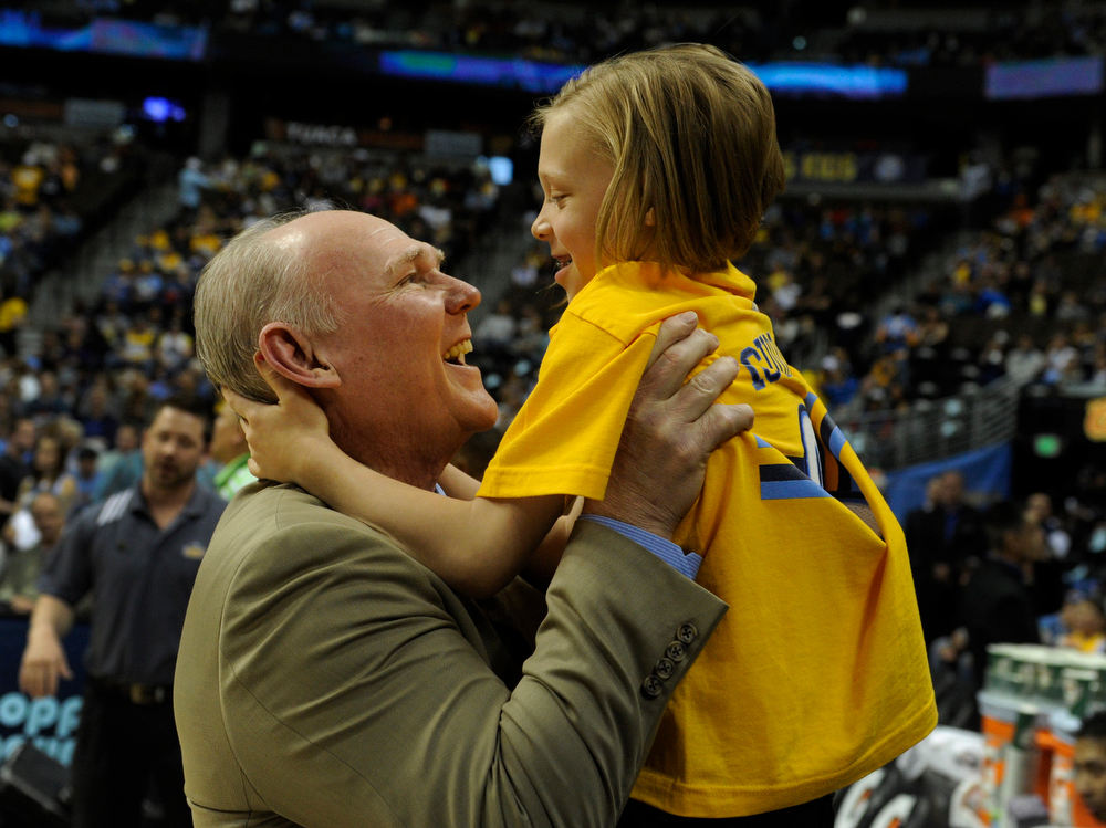 . Denver coach George Karl talked with his daughter Kaci Grace before the game. The Denver Nuggets hosted the Houston Rockets at the Pepsi Center Saturday night, April 6, 2013. Photo By Karl Gehring/The Denver Post)