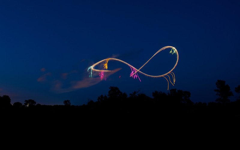 3 Aug 2011 : The infinite loop created during the night aerobatics display.  It's quite incredible what some of those pilots can do during the day, but then they combine that with night flying and having fireworks going off all around their plane – something really spectacular to behold.