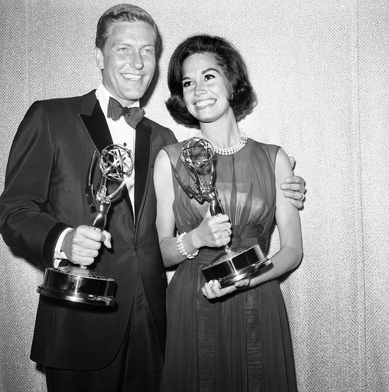 . Dick Van Dyke, left, and Mary Tyler Moore co-stars of The Dick Van Dyke Show pose backstage at the Palladium with the Emmys won in the Television Academys 16th annual awards show, May 25, 1964, Los Angeles, Calif. They won the best actor and actress in a series with their Emmys. (AP Photo)
