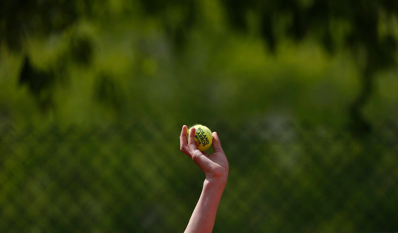 . A ball boy offers a ball to one of the serving players as Japan\'s Kei Nishikori defeats Canada\'s Jesse Levine in their first round match of the French Open tennis tournament, at Roland Garros stadium in Paris, Monday, May 27, 2013. (AP Photo/Petr David Josek)
