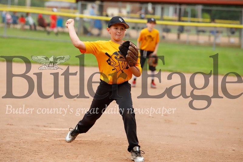 Ian Majors fires off a pitch in a Seneca Valley North Athletic Association 9-10 year old little league playoff game Monday night. His gold team fell to the blue team 9-3 in a game called early due to lightening. Seb Foltz Butler Eagle