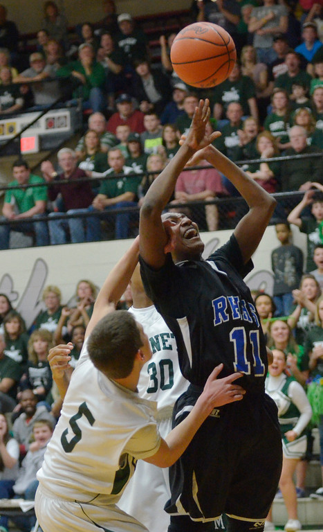 . Jeff Forman/JForman@News-Herald.com Christian Wilcox, Richmond Heights, is fouled in the second quarter by Jaret Majestic during the Spartans\' Division IV regional semifinal game against Malvern March 11 at the Canton Field House.