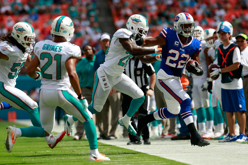 . Fred Jackson #22 of the Buffalo Bills is pushed out of bounds by Reshad Jones #20 of the Miami Dolphins at Sun Life Stadium on October 20, 2013 in Miami Gardens, Florida.  (Photo by Chris Trotman/Getty Images)