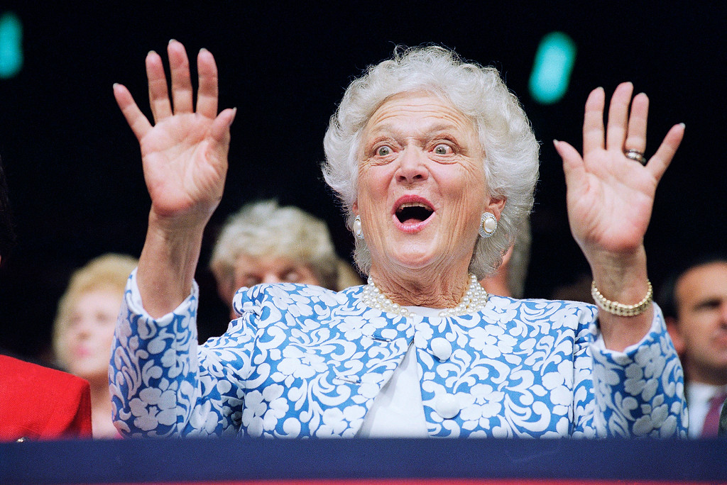 """. First Lady Barbara Bush reacts to Sen. Phil Gramm, who delivered the keynote address to the Republican National Convention at the Houston Astrodome, Tuesday, Aug. 18, 1992, Houston, Tex. Gramm derided Democratic candidate Bill Clinton\'s economic program as a \""""Lemon for America.\"""" (AP Photo/Marcy Nighswander)"""