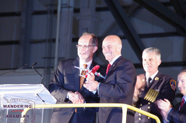 JetBlue CEO David Barger giving FDNY Commissioner Salvatore Cassano a model of Blue Bravest