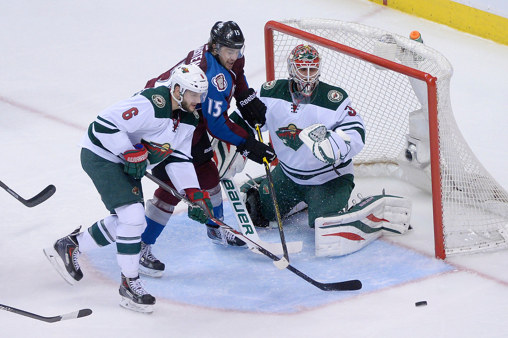 . P.A. Parenteau (15) of the Colorado Avalanche tries for a goal between Marco Scandella (6) and Ilya Bryzgalov (30) of the Minnesota Wild during overtime.  (Photo by Karl Gehring/The Denver Post)