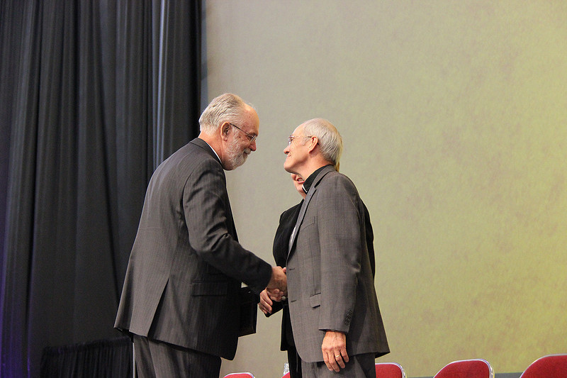 Nominees for secretary of the ELCA greet each other.