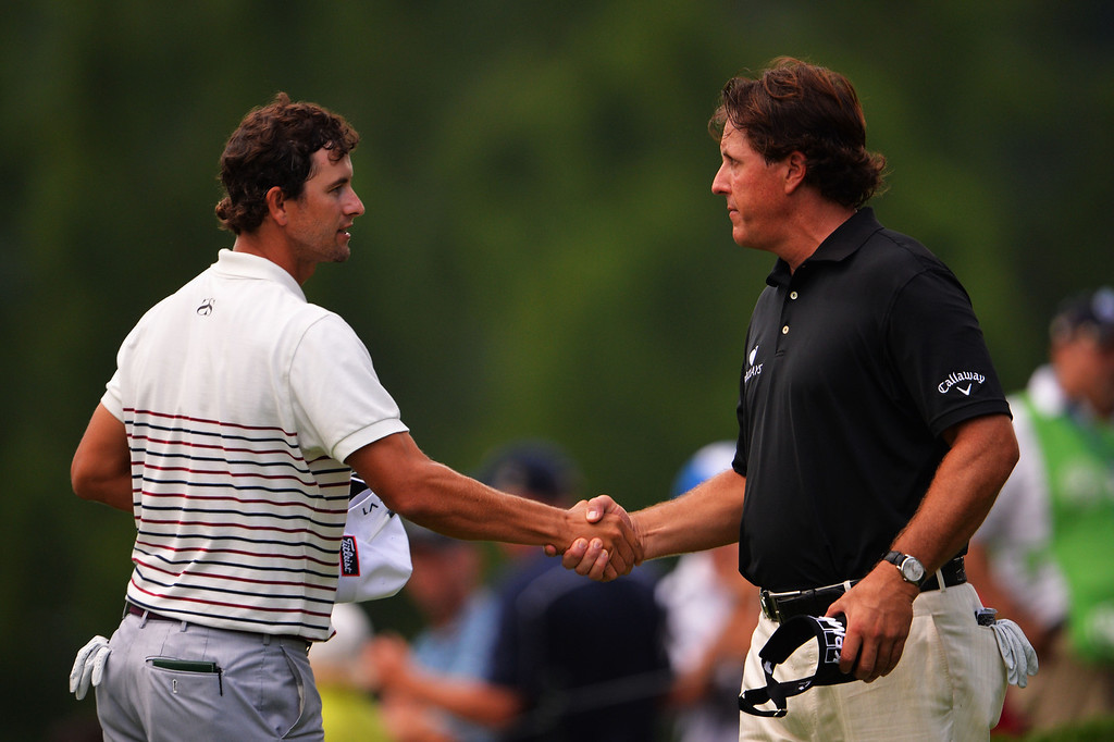 . ROCHESTER, NY - AUGUST 08:  (L-R) Adam Scott of Australia and Phil Mickelson of the United States finish their round on the 18th hole during the first round of the 95th PGA Championship on August 8, 2013 in Rochester, New York.  (Photo by Stuart Franklin/Getty Images)