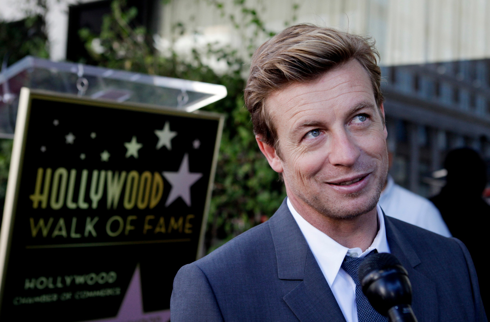 Description of . Australian actor Simon Baker is interviewed after ceremonies unveiling his star on the Hollywood Walk of Fame in Hollywood February 14, 2013.  REUTERS/Fred Prouser