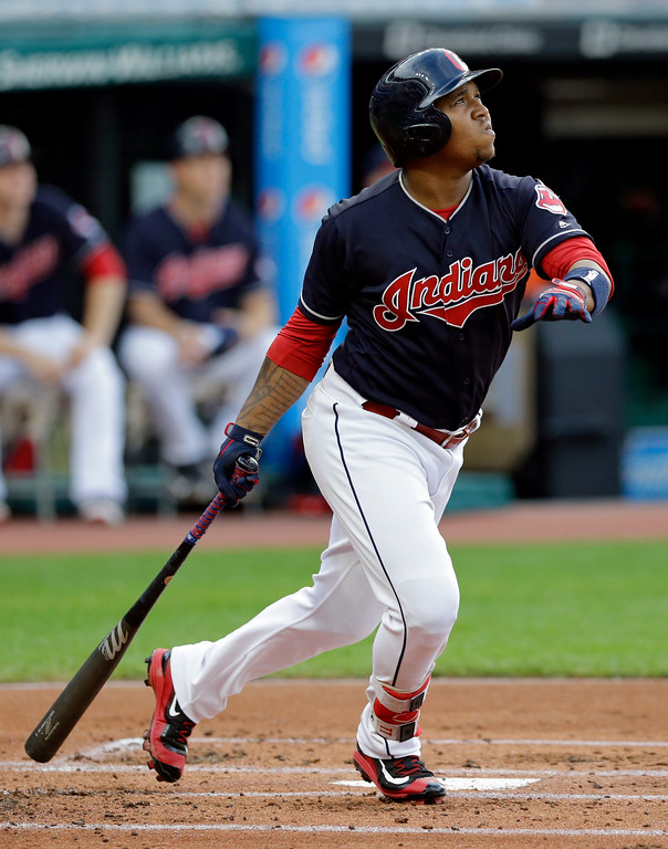 . Cleveland Indians\' Jose Ramirez watches his two-run home run off San Diego Padres starting pitcher Dinelson Lamet during the first inning of a baseball game, Thursday, July 6, 2017, in Cleveland. (AP Photo/Tony Dejak)