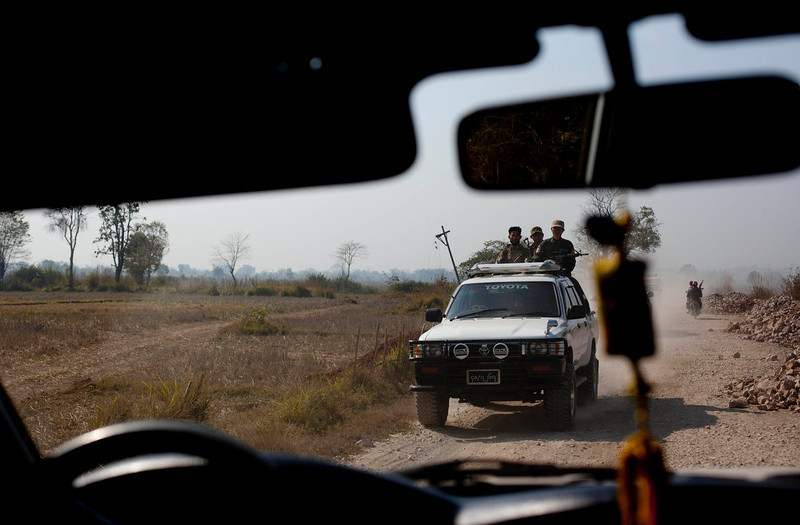 . Members of the Southern Shan militia group travel in a vehicle close to Mong Pan village, central Shan state, Myanmar on Feb 20, 2013. Far from Myanmar\'s postcard-perfect pagodas and colonial relics, the remote mountain villages of southern Shan State do not appear on maps of Myanmar or in any guide books. In obscurity, they have been ground zero for Myanmar\'s drug trade which has thrived on poverty and corruption. (AP Photo/Gemunu Amarasinghe)