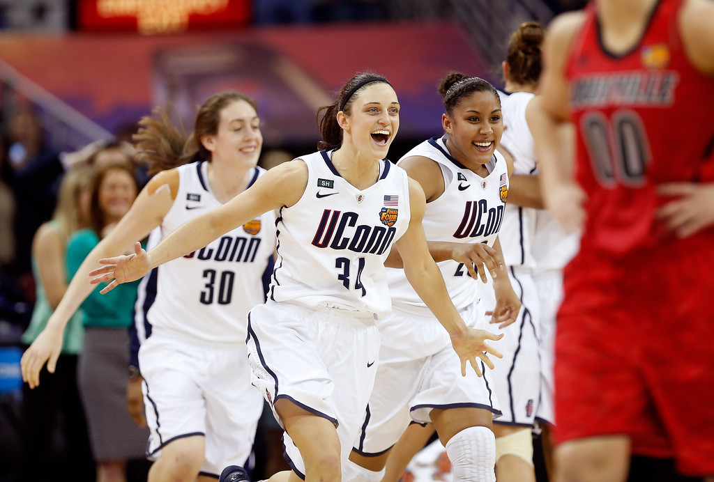 . Kelly Faris #34, Breanna Stewart #30 and Kaleena Mosqueda-Lewis #23 of the Connecticut Huskies run onto the court after defeating the Louisville Cardinals during the 2013 NCAA Women\'s Final Four Championship at New Orleans Arena on April 9, 2013 in New Orleans, Louisiana.  (Photo by Chris Graythen/Getty Images)