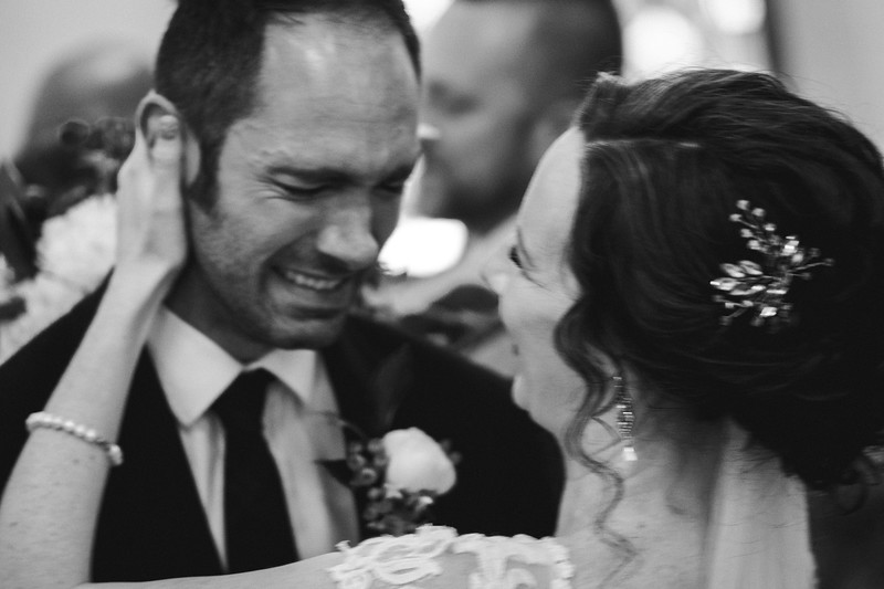 The bride embraces her Mike of Honor as he is overcome with emotion.