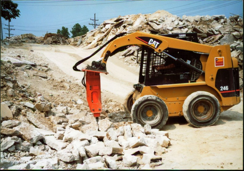 NPK E203 hydraulic hammer on Cat skid steer (Carr Bros 7-23-01) (1).JPG