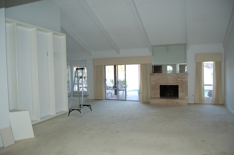 This was the living room, fireplace and all. The fireplace, the beams, the carpet, the bookcase (on the left) - all gone.