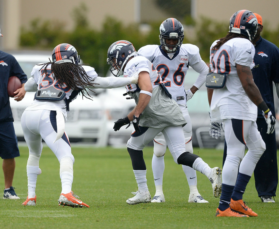 . Denver Broncos strong safety Quinton Carter (38) and Denver Broncos strong safety John Boyett (20) run through drills on day seven of the Denver Broncos 2014 training camp July 31, 2014 at Dove Valley. (Photo by John Leyba/The Denver Post)