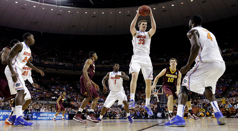 . Florida\'s Erik Murphy (33) pulls down a defensive rebound Minnesota during the first half of a third-round game of the NCAA college basketball tournament against Minnesota, Sunday, March 24, 2013, in Austin, Texas. (AP Photo/David J. Phillip)
