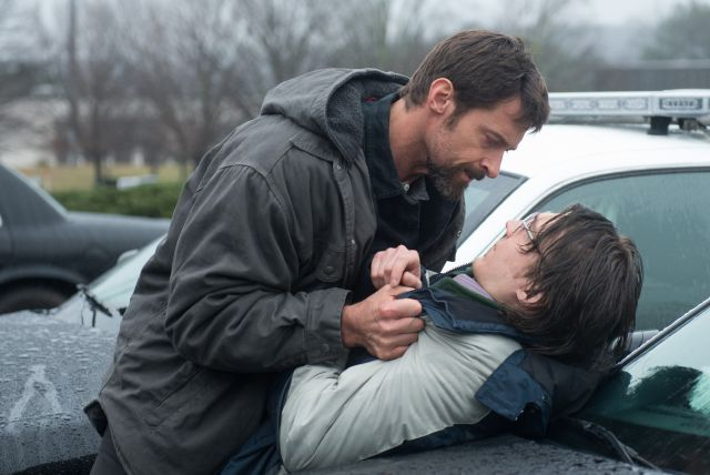 Description of . This image released by Warner Bros. Pictures shows Hugh Jackman, left, and Paul Dano in a scene from