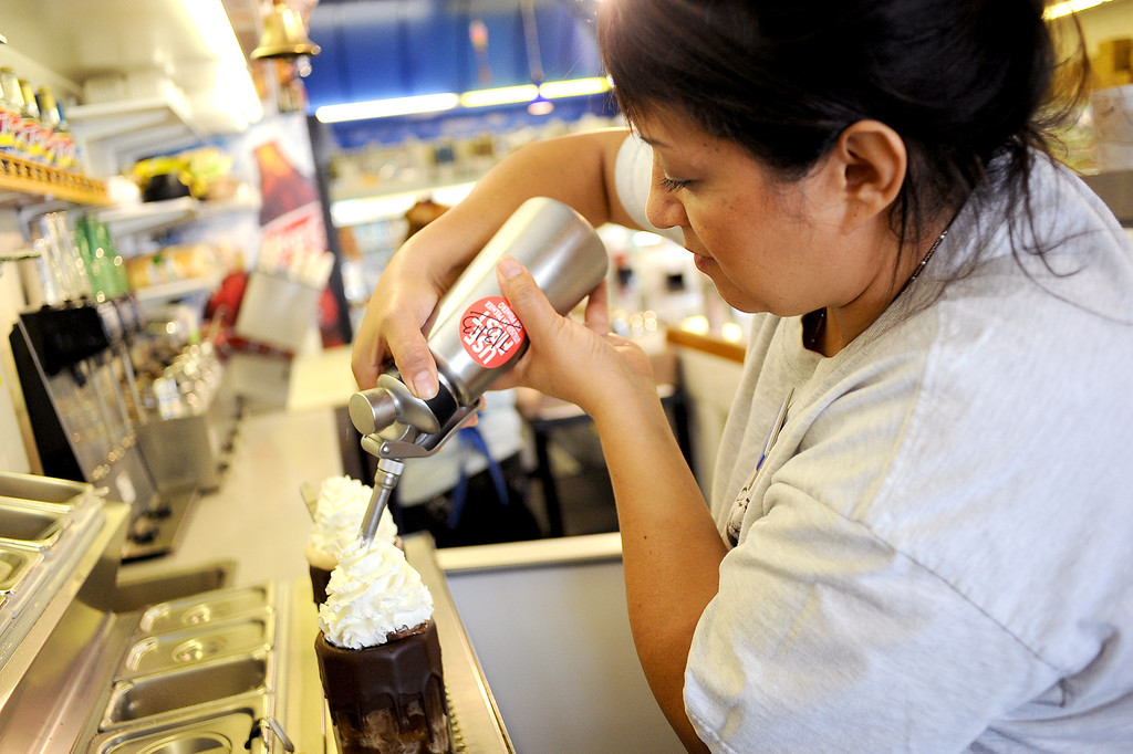 . Edith Moralses prepares an ice cream soda at Jerry\'s Soda Shoppe in Canoga Park, CA July 3, 2013.  The soda shop is located inside DeSoto Pharmacy and is featured in the  July issue of Food Network Magazine.(Andy Holzman/Los Angeles Daily News)