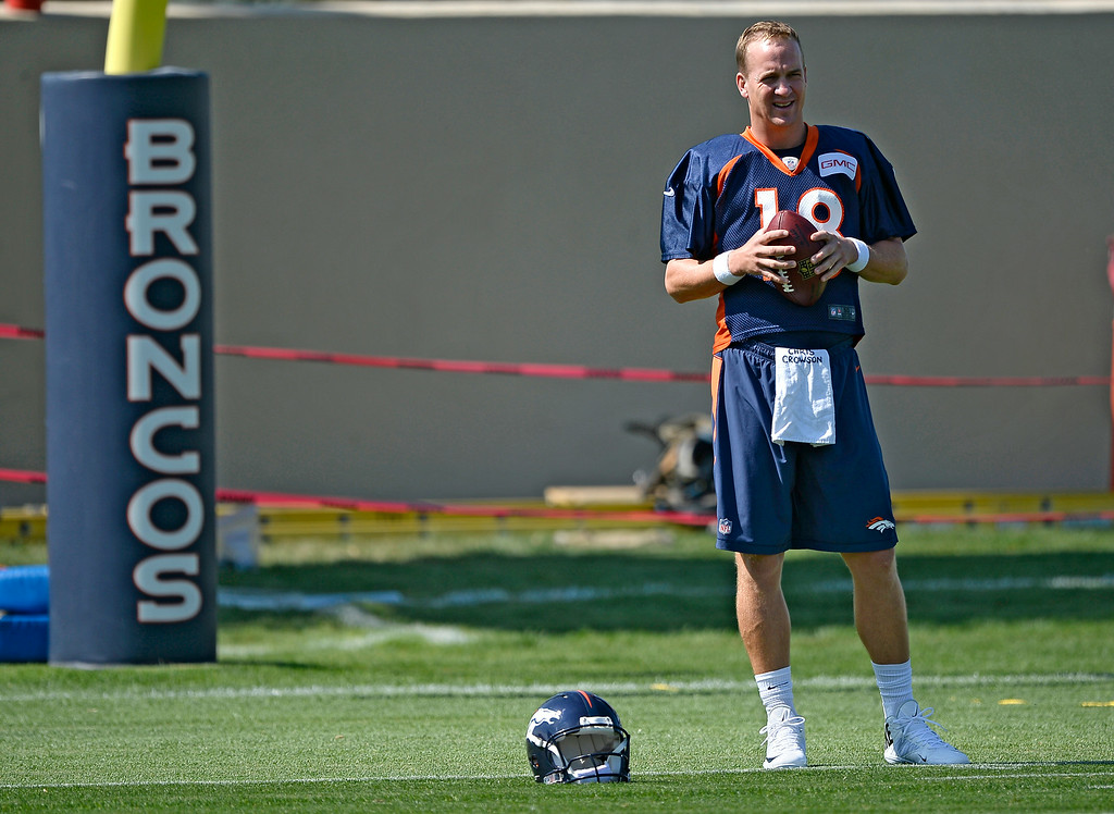 . Denver Broncos quarterback Peyton Manning (18) gets ready for drills on day two of the Denver Broncos 2014 training camp July 25, 2014 at Dove Valley. (Photo by John Leyba/The Denver Post)