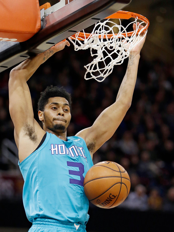 . Charlotte Hornets\' Jeremy Lamb dunks the ball in the second half of an NBA basketball game against the Cleveland Cavaliers, Friday, Nov. 24, 2017, in Cleveland. (AP Photo/Tony Dejak)