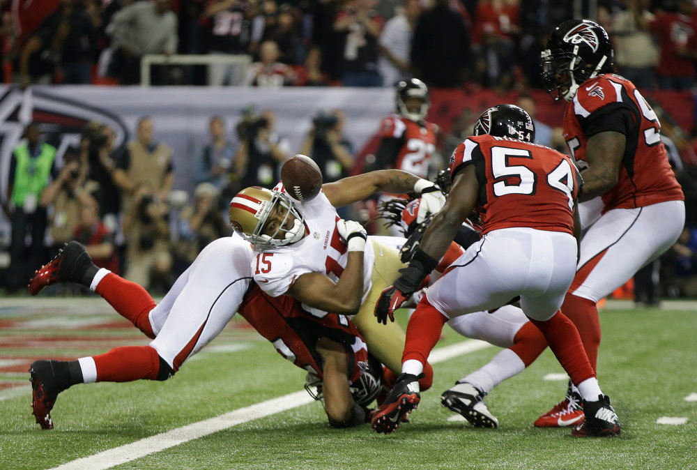 Description of . San Francisco 49ers\' Michael Crabtree (15) loses the ball neat the goal line during the second half of the NFL football NFC Championship game against the Atlanta Falcons Sunday, Jan. 20, 2013, in Atlanta. The Falcons recovered the fumble. (AP Photo/Mark Humphrey)