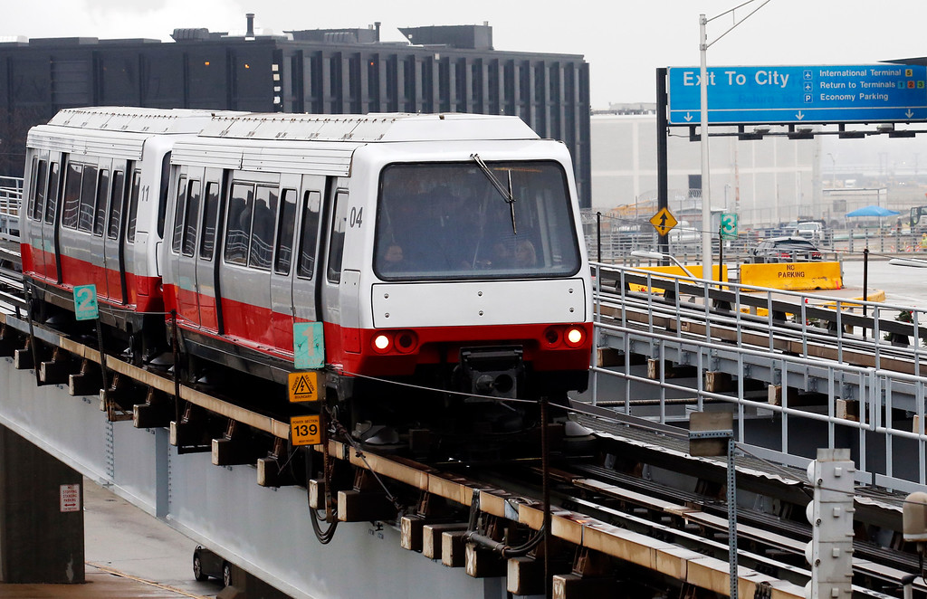 . Travelers ride on a shuttle train to terminals at O\'Hare International Airport in Chicago, Wednesday, Nov. 23, 2016. While driving remains the most popular form of transportation Thanksgiving travelers take, AAA expects just under 4 million people to fly to their holiday destinations. (AP Photo/Nam Y. Huh)