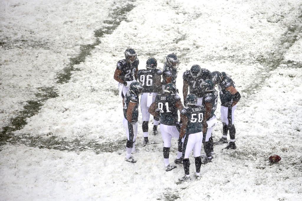 . Philadelphia Eagles huddle during the second half of an NFL football game against the Detroit Lions, Sunday, Dec. 8, 2013, in Philadelphia. (AP Photo/Matt Rourke)